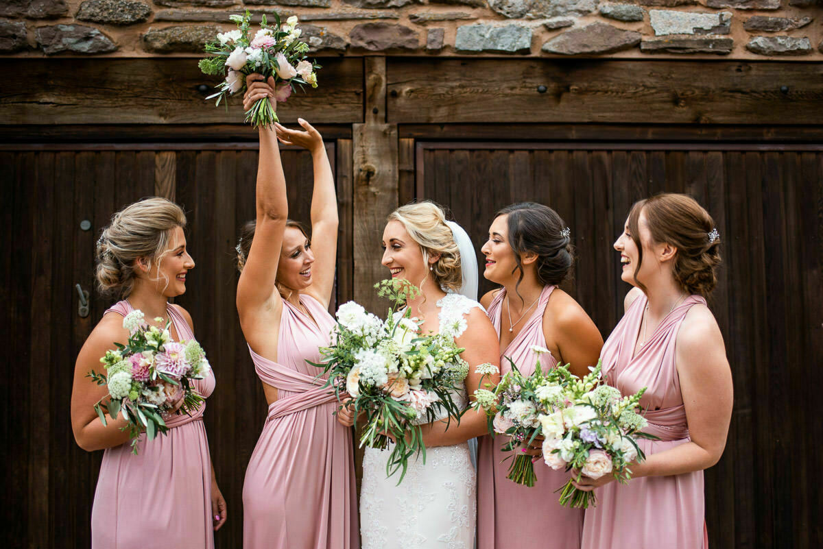 Bride with bridesmaids and wedding boquets