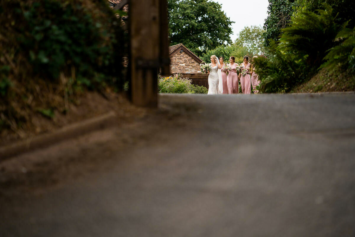 Bride on the way to church with bridesmaids