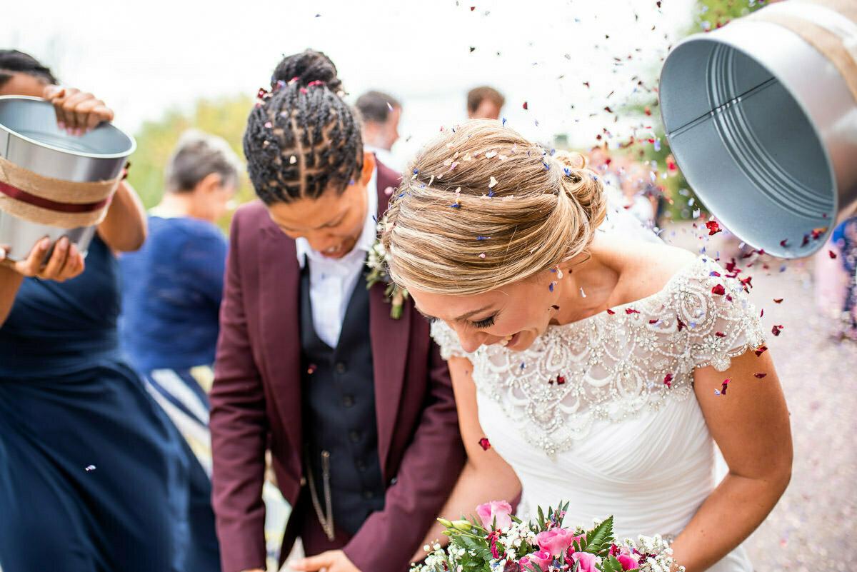 brides covered in confetti
