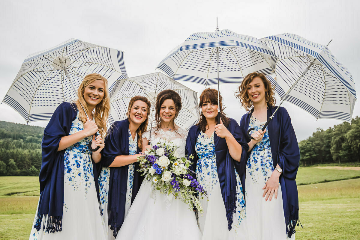Bride and bridesmaids with umbrellas