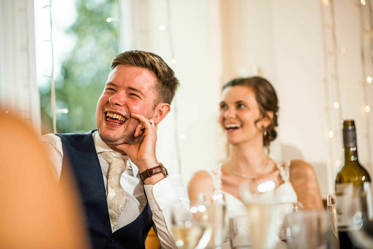 Groom and bride during speeches at Delbury Hall