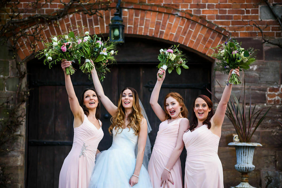 Bride and bridesmaids flowers, dresses at Brinsop court