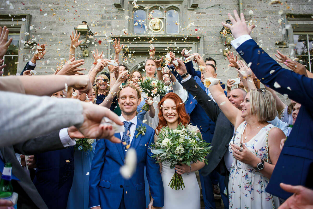 Guests throwing confetti at Lemore Manor