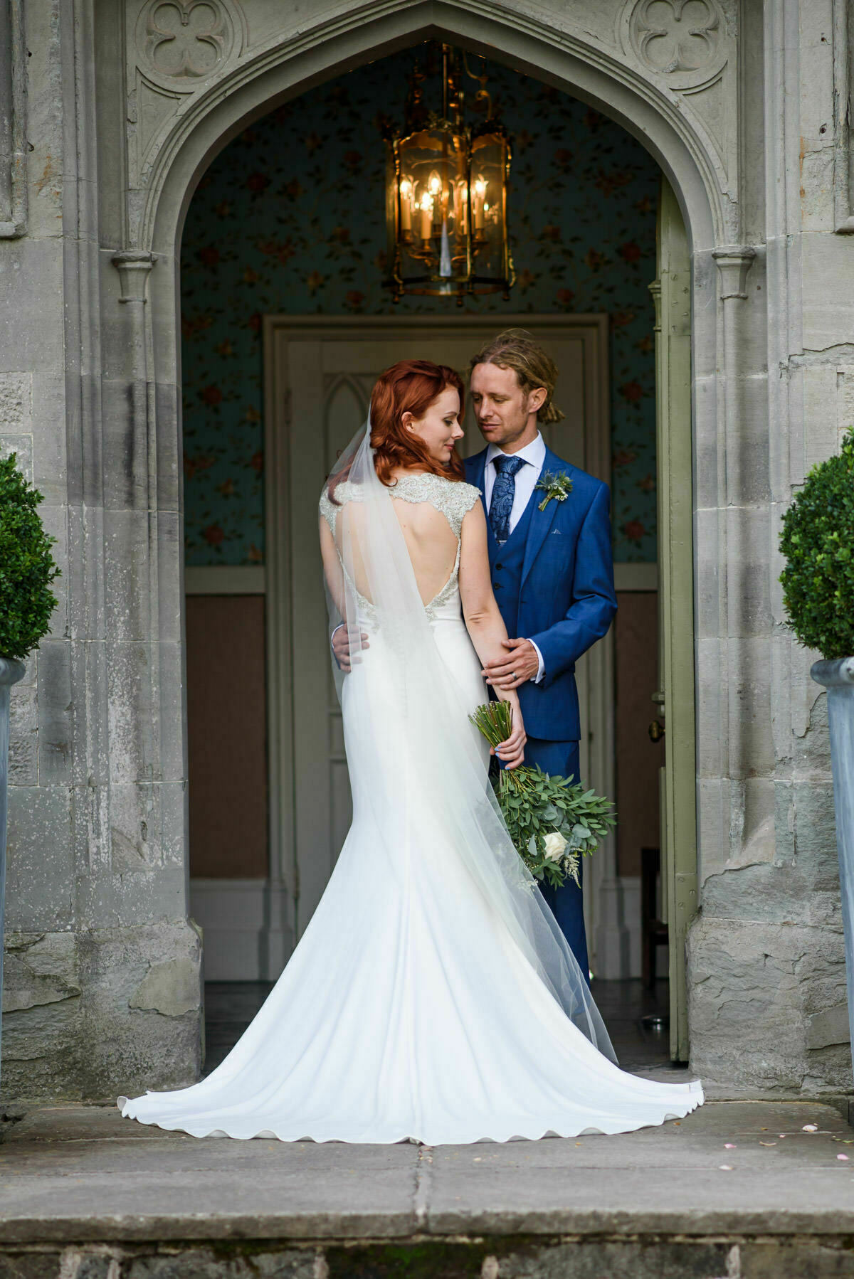 Bride and Groom portrait by Lemore Manor front door
