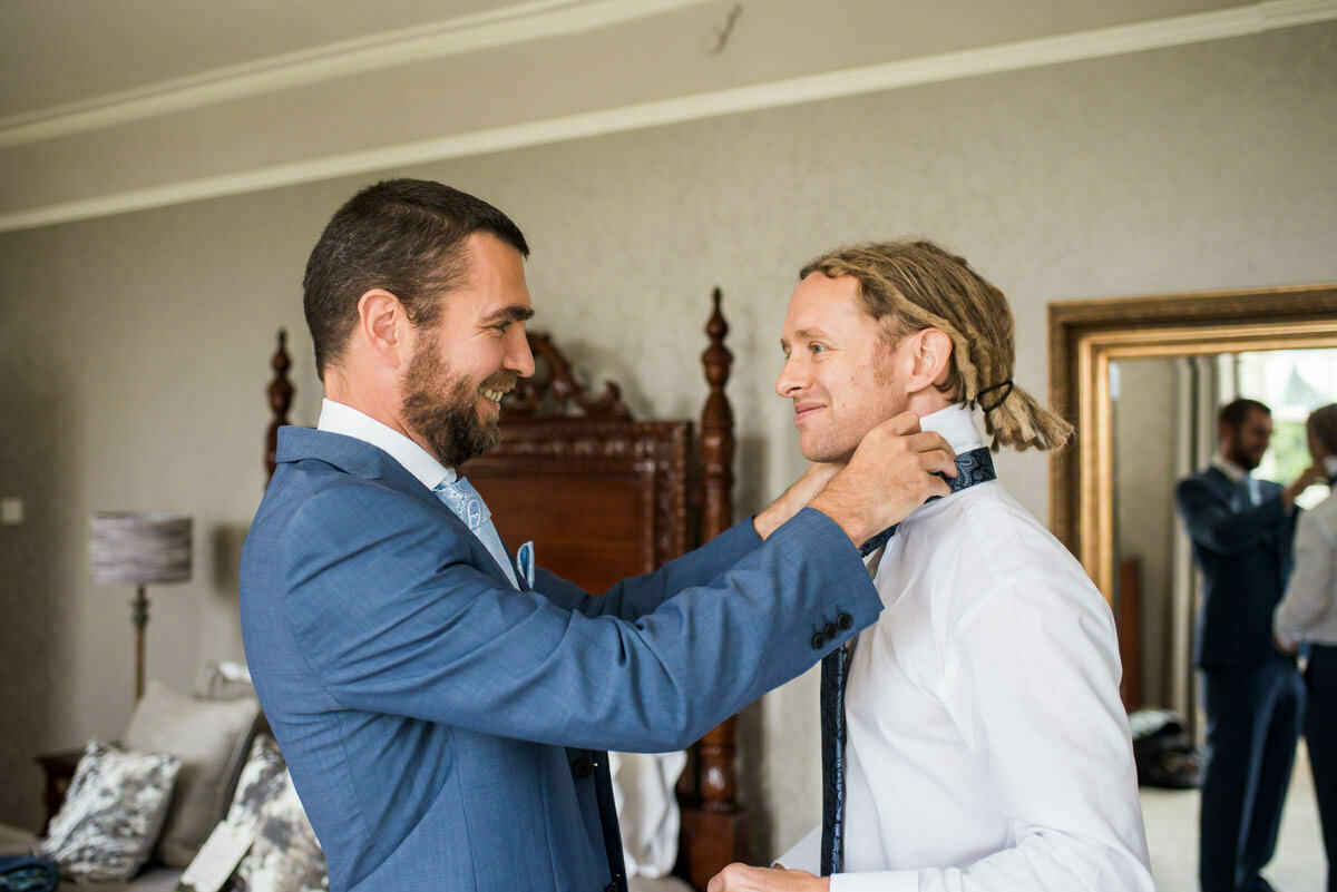 Groom getting ready at Lemore Manor