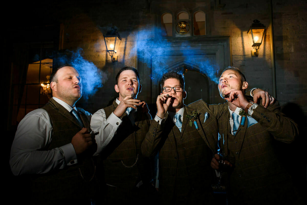 Groom and groomsmen smoking