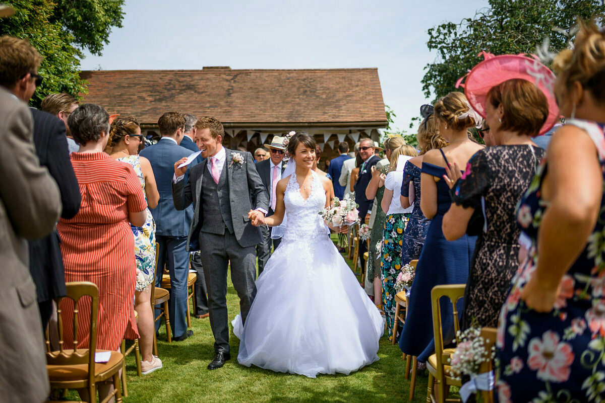 walking down the aisle at Herefordshire wedding