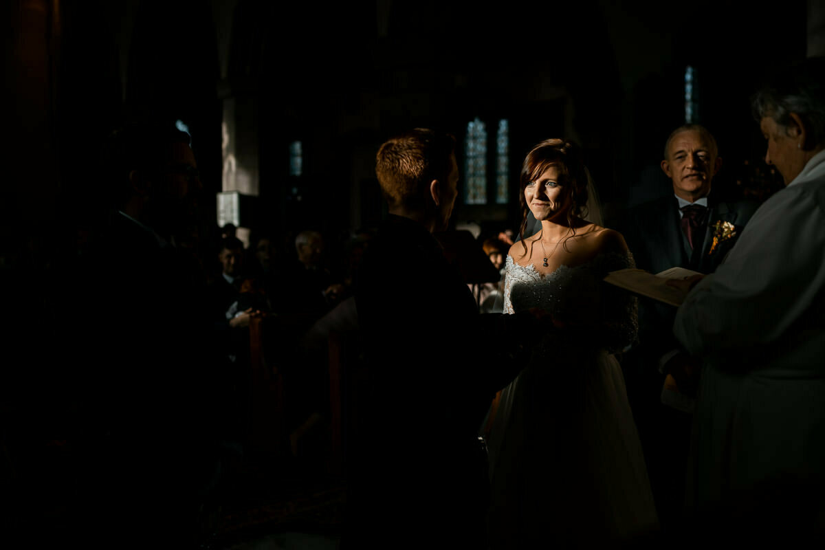Bride in church before Brinsop Court wedding reception