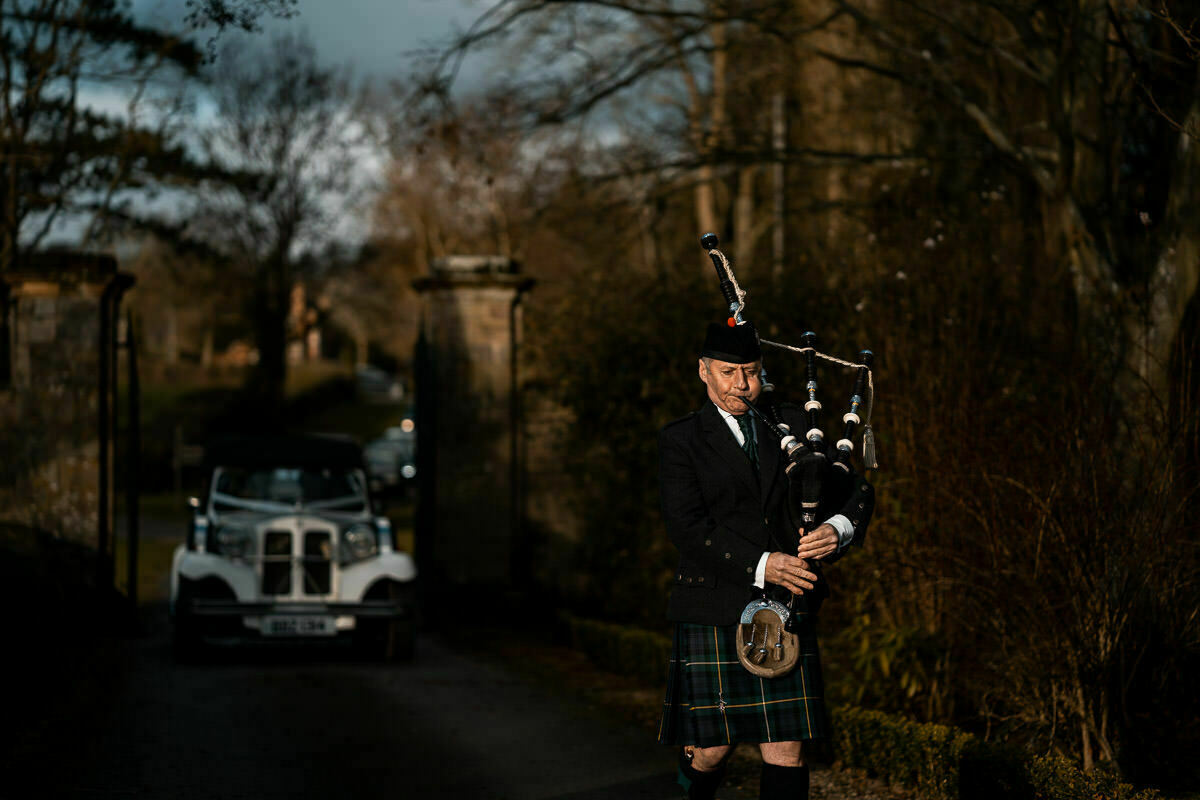 Bag piper at Brinsop Court wedding