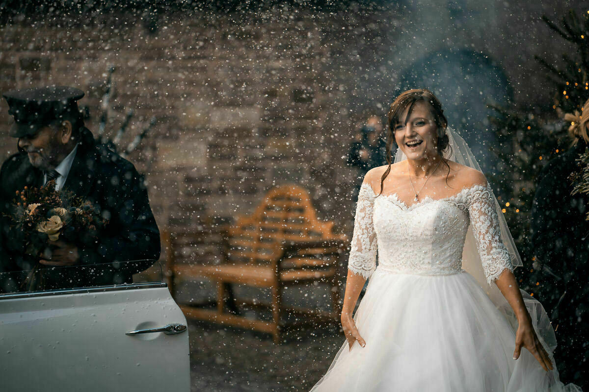 Bride in snow at Brinsop Court
