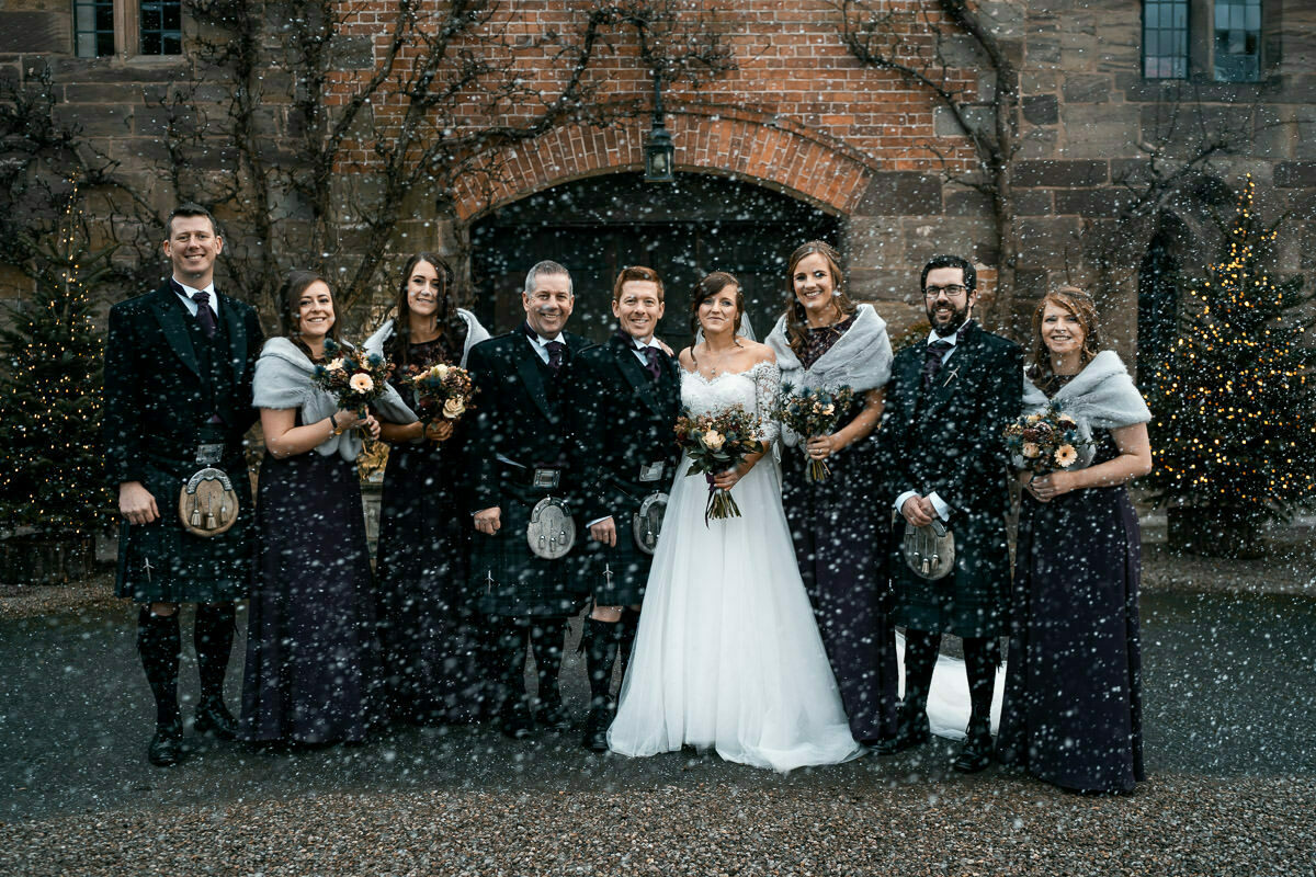 Christmas wedding with snow at Brinsop Court