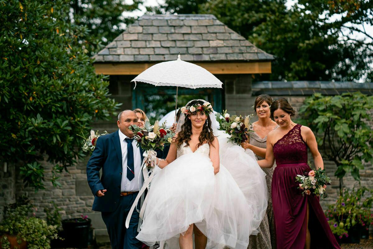 Bride making her way to wedding ceremony
