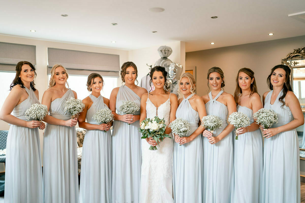 bride and her bridesmaids with flowers