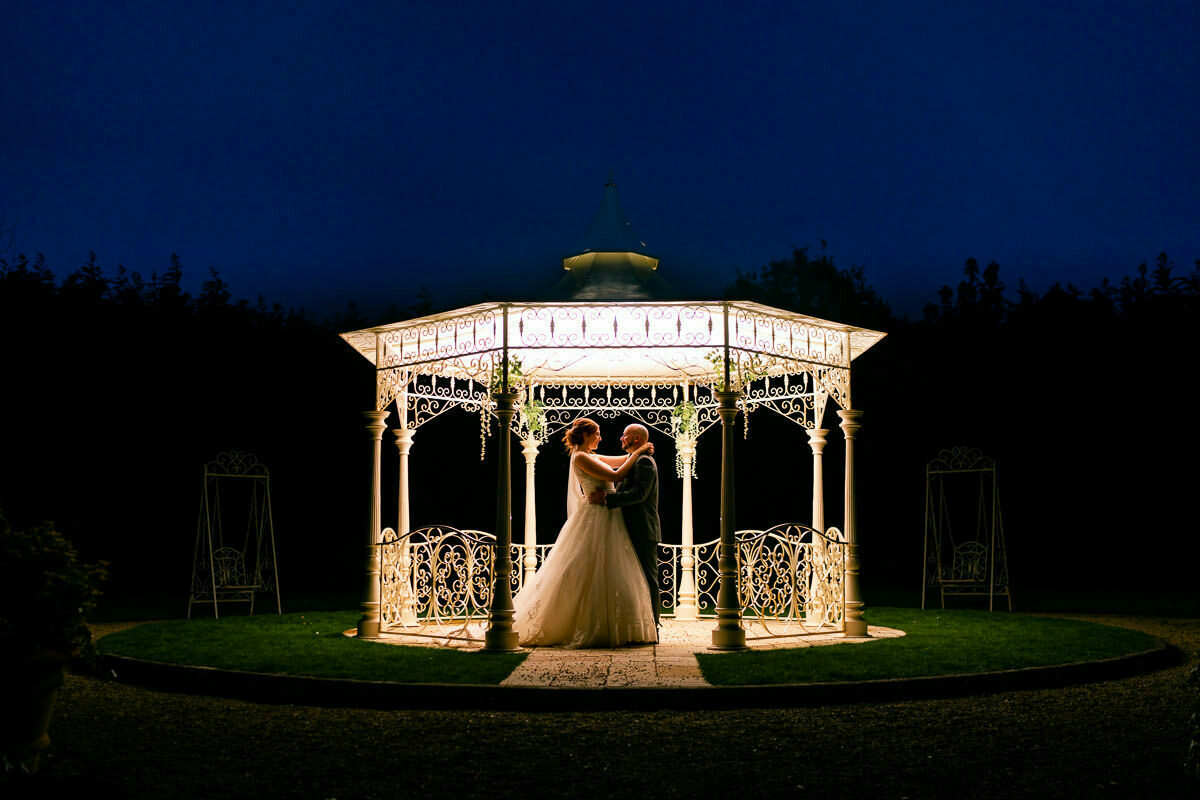 night time wedding photograph at manor by the lake